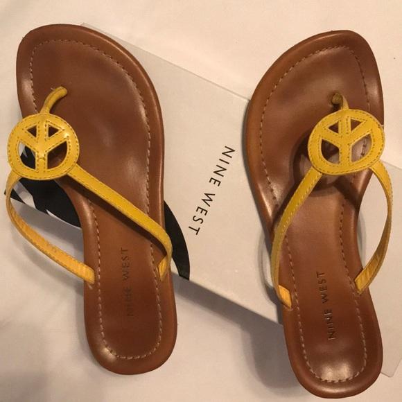 Nine West yellow peace sign flip flops. 982f69e62